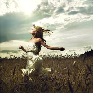 Girl running across field